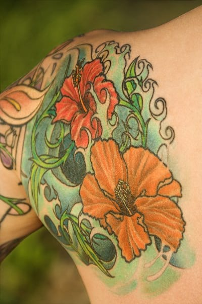 Beautiful sleeve tattoo with some floral art